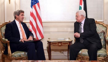 U.S. Secretary of State John Kerry meets Palestinian President Mahmoud Abbas in a hotel in Paris, France, July 30, 2016.