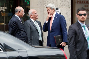 U.S. Secretary of State John Kerry talks with PLO head Saeb Erekat, Paris, France, July 30, 2016.