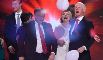 Democratic presidential nominee Hillary Clinton celebrates on stage with husband Bill and running mate Tim Kaine on final night of the Democratic National Convention.