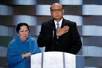 Khizr Khan, father of fallen US Army Capt. Humayun S. M. Khan, and his wife Ghazala appear at the DNC in Philadelphia, July 28, 2016.