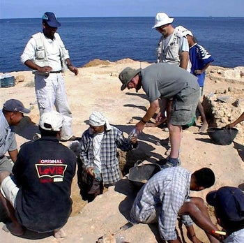 Excavating a burial on Aboukir Island, also known as Nelson's Island, in the Mediterranean off the Egyptian coast, near Alexandria.