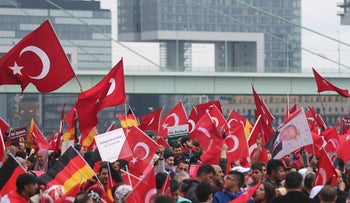 Supporters of Turkish President Recep Tayyip Erdogan attend a rally in Cologne, Germany on July 31, 2016.