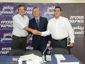 MK Erel Margalit with Yuval Rabin and Fathi Amara in Tel Aviv, July 31, 2016.