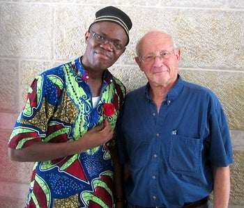 Dr. Chobufo Ditah, left, wearing hat and colorful shirt, and Prof. Jeremy Kark, wearing blue shirt, both wearing glasses: They studied the effects of high-density cholesterol on Israelis and Palestinians, at the Hebrew University-Hadassah Braun School of Public Health and Community Medicine.