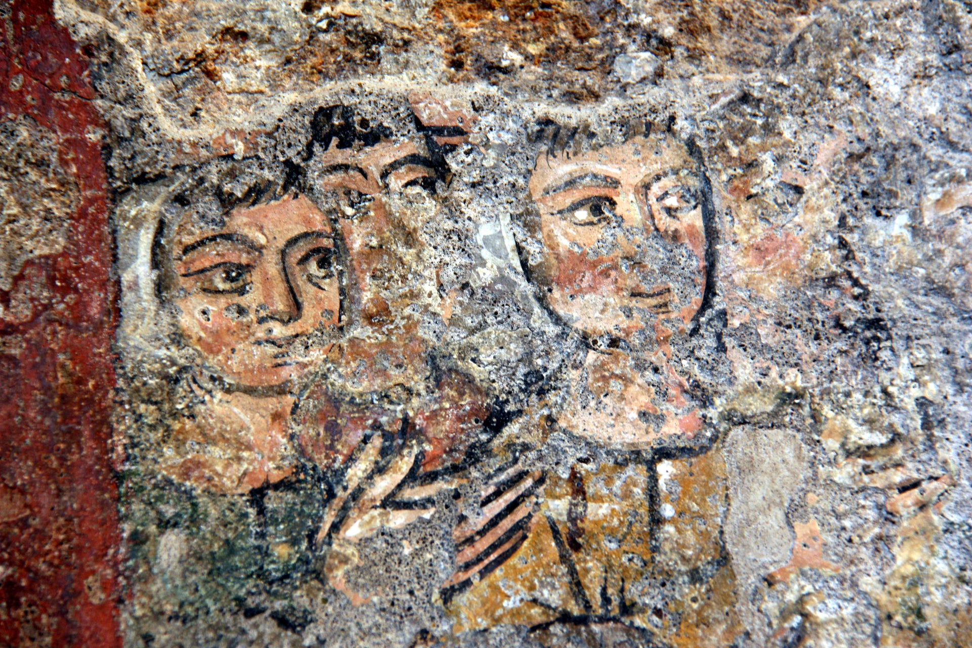 13th-century fresco of Christians praying, in the upper level of the Tullianum, which was transformed into a church during the Middle Ages.