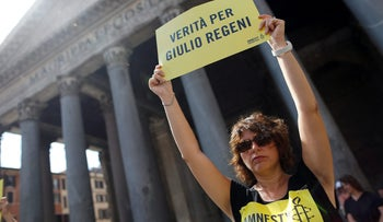 "An Amnesty International activist holds a placard reading ""truth for Giulio Regeni"" as she takes part in protest against disappearance of the Italian student, July 13, 2016."