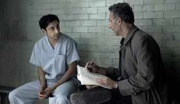 In this image released by HBO, Riz Ahmed, left, and John Turturro appear in a scene from 'The Night Of.'
