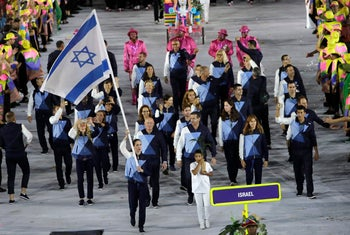 Neta Rivkin carries the Israeli flag during the opening ceremony for the 2016 Summer Olympics in Rio de Janeiro, Brazil, August 5, 2016.