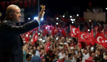 Turkish President Tayyip Erdogan greets his supporters outside of his residence in Istanbul, Turkey, July 19, 2016.