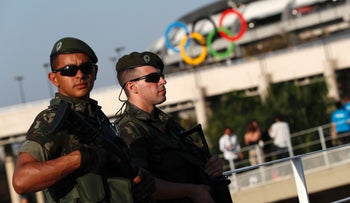 Brazilian security forces stand guard outside the Maracana stadium in Rio de Janeiro, Brazil, August 5, 2016.