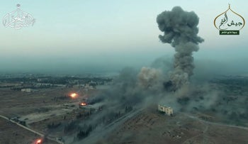 An image grab taken from a video released by Jabhat Fatah al-Sham shows smoke billowing from an artillery school south of Aleppo, Syria, August 6, 2016.