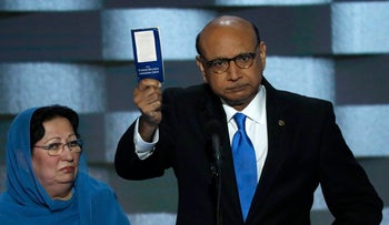 Khizr Khan offers to loan his copy of the Constitution to Donald Trump while his wife looks on at the Democratic National Convention in Philadelphia, Pennsylvania on July 28, 2016.
