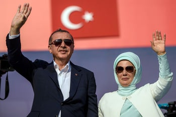 Turkish President Recep Tayyip Erdogan and his wife Emine Erdogan wave at supporters during a rally against the failed military coup of July 15 in Istanbul, Turkey, August 7, 2016.