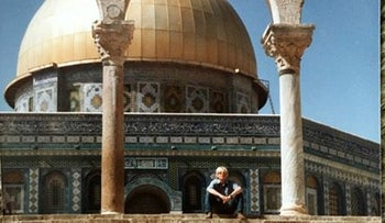 Britain's Foreign Secretary Boris Johnson on his first trip to Israel in the summer of 1984. Johnson sits on the top step of a flight of steps leading to the golden-domed Dome of the Rock, in Jerusalem.
