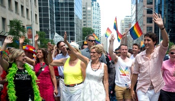 Green Party leader Elizabeth May, left,  marching in the 2016 Gay Pride Parade in Toronto with Canadian Premier Kathleen Wynne and Canadian Prime Minister Justin Trudeau.