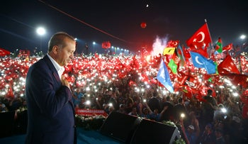 Turkish President Recep Tayyip Erdogan thanks millions of his supporters at the 'Democracy and Martyrs' Rally' in Istanbul on August 7, 2016.