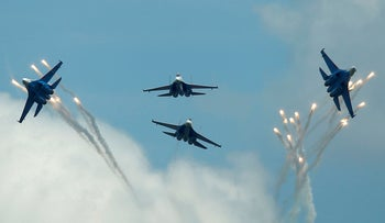 Sukhoi Su-27 jet fighters of the Russkiye Vityazi aerobatic team fly in formation in Dubrovichi outside Ryazan, Russia, August 5, 2016.