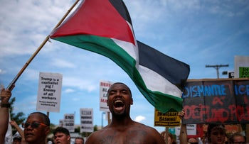 Demonstrators wave the Palestinian flag and chant slogans during a march by various groups, including 'Black Lives Matter' in Cleveland, Ohio, U.S., July 17, 2016.