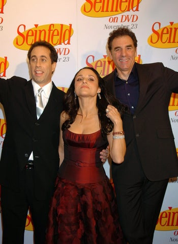 Jerry Seinfeld, left, Julia Louis Dreyfus and Michael Richards arrive to celebrate the release of the first three seasons of Seinfeld on DVD, Wednesday, Nov. 17, 2004, in New York. (AP Photo/ Louis Lanzano)