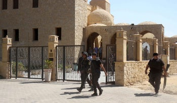 Egyptian police on August 5, 2016 at the site of an earlier shooting in a Cairo suburb.