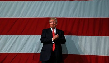 Republican U.S. presidential nominee Donald Trump attends a campaign rally in Fayetteville, North Carolina August 9, 2016.