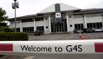 A G4S Plc logo sits on a barrier outside the company's headquarters in Crawley, U.K.
