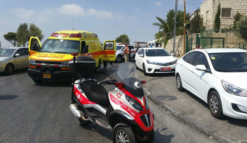 Emergency vehicles at the scene of a stabbing attack in East Jerusalem on August 11, 2016.