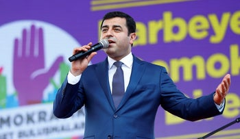 The leader of Turkey's pro-Kurdish opposition Peoples' Democratic Party Selahattin Demirtas makes a speech during a rally in Istanbul, Turkey, June 5, 2016.