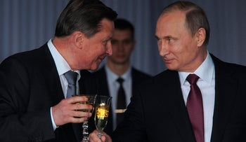 Russian President Vladimir Putin toasts with former chief of staff Sergei Ivanov during a reception celebrating, Moscow, Russia, June 12, 2016.