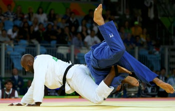 Teddy Riner (FRA) of France and Or Sasson (ISR) of Israel compete.