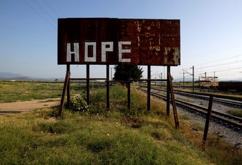 A rusty sign stands next to railway tracks where the refugees and migrants makeshift camp was at the Greek-Macedonian border near the village of Idomeni, Greece, August 10, 2016.
