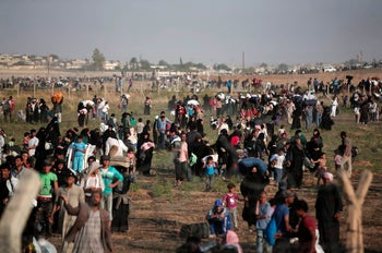 Thousands of Syrian refugees walking in order to cross into Turkey, June 2015.
