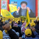 People watch Hezbollah leader Hassan Nasrallah as he speaks at an event marking the 16th anniversary of Israel's withdrawal from southern Lebanon, Bekaa valley, Lebanon, May 25, 2016.