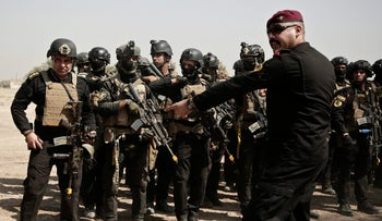 Soldiers from the 1st Battalion of the Iraqi Special Operations Forces take part in during a training exercise to prepare for the operation to re-take Mosul from ISIS on August 13, 2016.