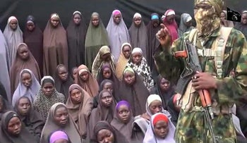 This screenshot created on August 14, 2016 taken from a video released on youtube purportedly by Boko Haram, shows what is claimed to be fighters with girls allegedly kidnapped in April 2014.