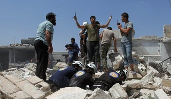 Men and civil defense members look for survivors from under the rubble after an airstrike on the rebel held village of Taftanaz, Idlib, Syria, August 13, 2016.