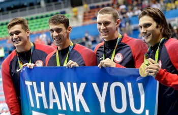 Nathan Adrian, Michael Phelps, Ryan Murphy and Cody Miller after winning the gold in the men's 4 x 100-meter medley, Rio, August 14, 2016.