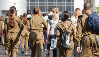 Soldiers in Tel Aviv. (Subjects in this photo are not featured in the article).