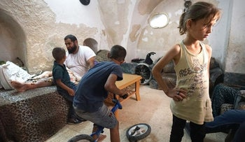 The Burqan family with their infamous bicycle, broken by Israeli forces in Hebron
