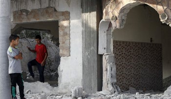 Palestinian youth inspect the damage after the Israeli army partially destroyed the house of late Mohammed Nasser Tarayrah, a Palestinian attacker who stabbed to death an Israeli teen in a Jewish settlement, on August 15, 2016 in the village of Bani Naim, near the Palestinian city of Hebron. Mohammed Nasser Tarayrah, 19, broke into a house in the Kiryat Arba Jewish settlement where Hallel Yaffa Ariel was sleeping and stabbed the 13-year-old Israeli-American dozens of times in his bed. Tarayrah was himself killed by settlement guards on June 30, 2016. Israel frequently destroys the homes of Palestinians who have carried out attacks.