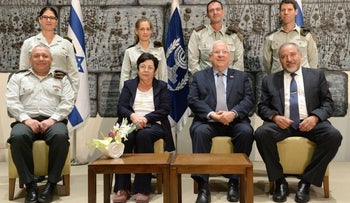 Defense Minister Avigdor Lieberman, far right, and President Reuven Rivlin next to him at a swearing-in of military judges, Jerusalem, August 15, 2016.