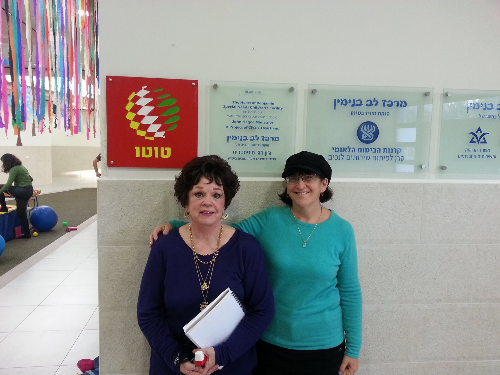 Margy Pezdirtz (left) and Sondra Baras, co-chairs of Christian Friends of Israeli Community, at a center for disabled children supported by their organization in the Jewish settlement of Ofra.