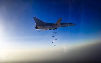 In this frame grab provided by Russian Defence Ministry press service, Russian long range bomber Tu-22M3 flies during an air strike over Aleppo region of Syria on Tuesday, Aug. 16, 2016. Russia's Defense Ministry said on Tuesday Russian warplanes have taken off from a base in Iran to target Islamic State fighters in Syria.