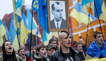 Activists of the Svoboda Ukrainian nationalist party carrying a portrait of Stepan Bandera at a rally, 2013.