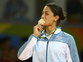 Yarden Gerbi kisses her bronze medal for judo in the 2016 Summer Olympics.