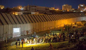 """""""Disturbing the Peace"""" screened on West Bank separation wall."""