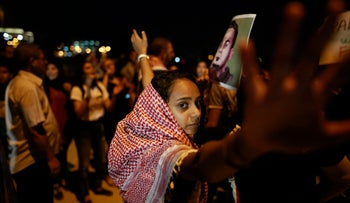 People protest the detention of Bilal Kayed outside of the Barzilai Medical Center in Ashkelon, where he is held, August 9, 2016.