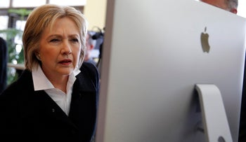 U.S. Democratic presidential candidate Hillary Clinton looks at a computer screen during a campaign stop at Atomic Object company in Grand Rapids, Michigan, U.S. March 7, 2016.