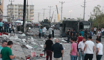 People surround the scene of a bomb blast in eastern Turkey earlier this month.