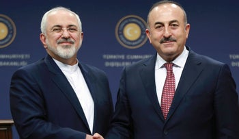 Turkish Foreign Minister Mevlut Cavusoglu and Iranian Foreign Minister Mohammad Javad Zarif shake hands following a joint press conference, Ankara, Turkey, August 12, 2016.